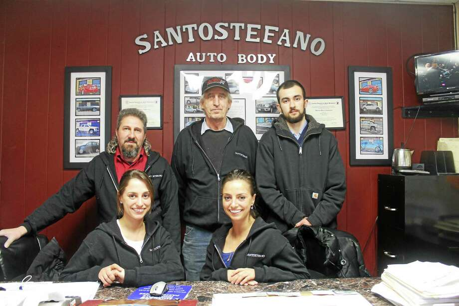 Santostefano Auto Body is now run by the founder's granddaughters, fraternal twins Sabrina, left, and Adriana Indomenico, who are working together, along with long-time employees Joe Russo, Mark Reiman and newcomer Nick Pagani. Photo: Valerie Bannister — Special To The Press