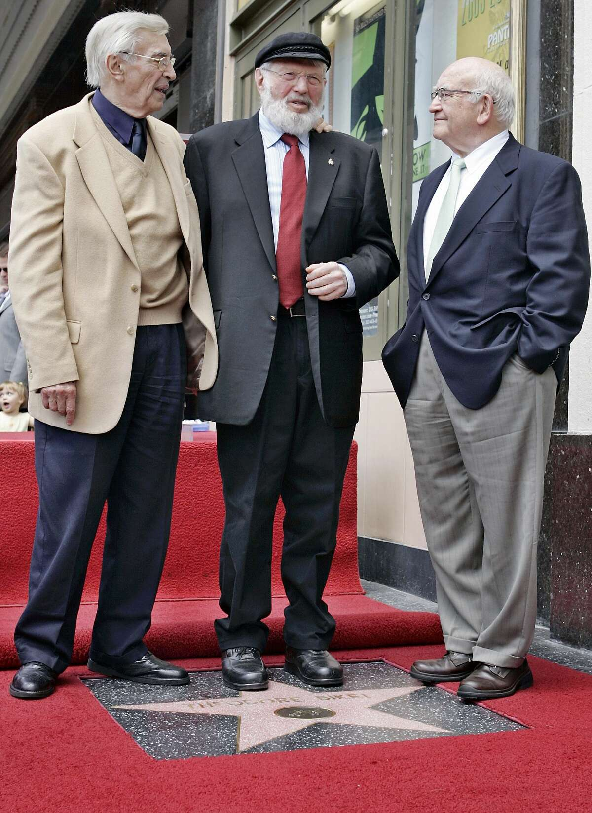 In this file photo, Theodore Bikel, center, with fellow actors Martin Landau, left, and Ed Asner, poses for photos during a dedication ceremony for Bikel's star on the Hollywood Walk of Fame in Los Angeles. Bikel, the Tony- and Oscar-nominated actor and singer whose passions included folk music and political activism, died Tuesday morning of natural causes at UCLA Medical Center in Los Angeles, said his agent Robert Malcolm. He was 91.