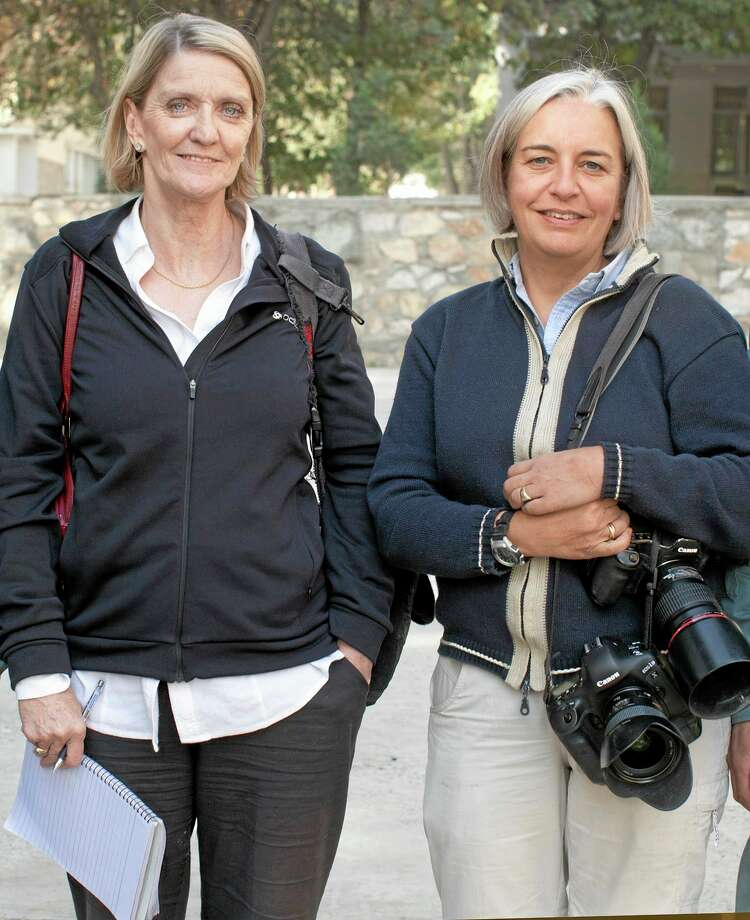 FILE - This 2012 file photo shows Kathy Gannon, left, Associated Press special correspondent for Afghanistan and Pakistan, and AP photographer Anja Niedringhaus in Afghanistan. A Kabul court announced Wednesday, July 23, 2014 that the Afghan police officer charged with killing Associated Press photographer Anja Niedringhaus and wounding veteran AP correspondent Kathy Gannon has been convicted and sentenced to death.(AP Photo, File) Photo: AP / AP