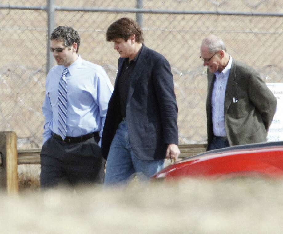 FILE - In this March 15, 2012 file photo Former Illinois Gov. Rod Blagojevich, center, walks with attorneys as he arrives at the Federal Correctional Institution Englewood in Littleton, Colo., to begin serving his 14-year sentence for corruption. The 7th U.S. Circuit Court of Appeals overturned some of the corruption convictions of the imprisoned former Governor in a ruling released Tuesday, July 21, 2015, saying prosecutors did not prove Blagojevich broke the law as he appeared to try to auction off an appointment to President Barack Obama's old Senate seat. (AP Photo/Ed Andrieski,File) Photo: AP / AP