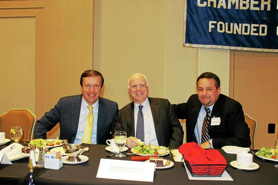 U.S. Sens. Chris Murphy, left, and John McCain, center, chat with Chamber Chairman Rich Carella before the chamber's Special Member Luncheon and Book Signing event last Monday. Photo: Contributed Photo
