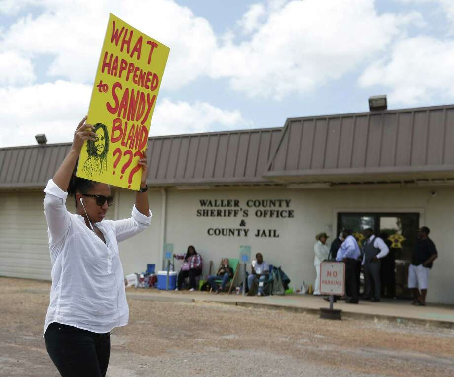 Brandi Holmes, of Houston, carries a sign as she protests in front of the Waller County Sheriff's Office and county jail on Monday in Hempstead, Texas. Authorities said Bland hanged herself in the jail three days after being pulled over by police for a traffic violation and then arrested for allegedly kicking an officer during the stop. Bland's family is ordering an independent autopsy, lawyers said. Photo: Karen Warren/Houston Chronicle Via AP  / Houston Chronicle