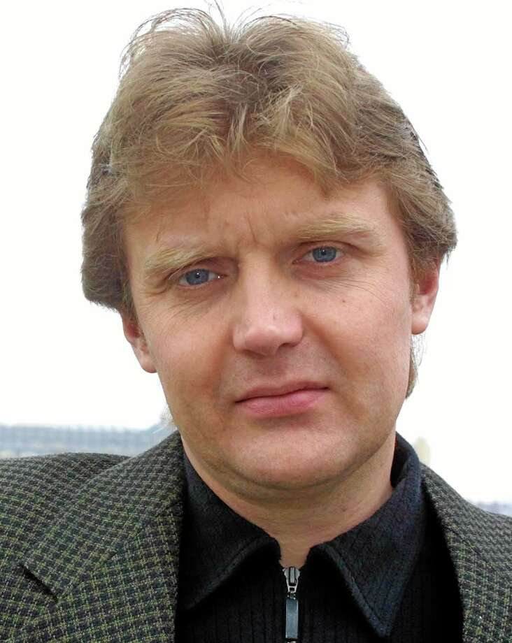 """In this Friday, May 10, 2002, file photo, Alexander Litvinenko, former KGB spy and author of the book, """"Blowing Up Russia: Terror From Within,"""" is photographed at his home in London. The British government Tuesday announced plans for a wide-ranging public inquiry into the 2006 death of poisoned ex-Russian spy Litvinenko. The decision, which comes at a time of rising tensions with Russia, means investigators can look into whether the Russian state played a role in Litvinenko's demise. Photo: AP Photo — Alistair Fuller, File   / AP"""