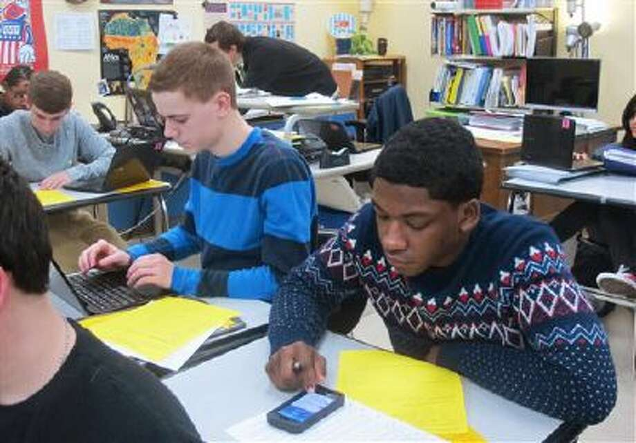 Hunter Waslicki, left, and Julian Barnes log onto Twitter for a classroom exercise at Wauwatosa West High School in Wauwatosa, Wis. While many school officials frown upon the use of social media in the classroom, an increasing number of teachers see Twitter as a way to expand a classroom discussion to include diverse viewpoints from students around the country. Photo: AP / AP