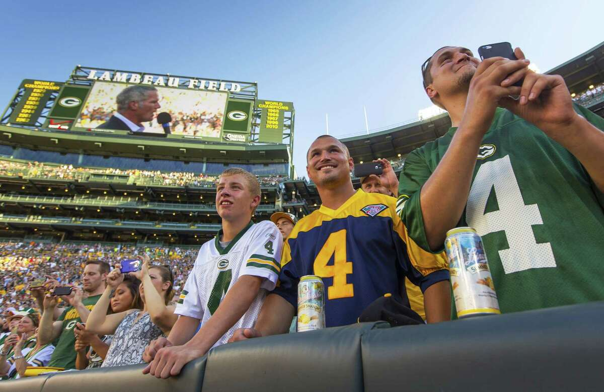 Fans watch former Green Bay Packers quarterback Brett Favre give a speech at Lambeau Field prior to his induction to the Packers Hall of Fame on Saturday.