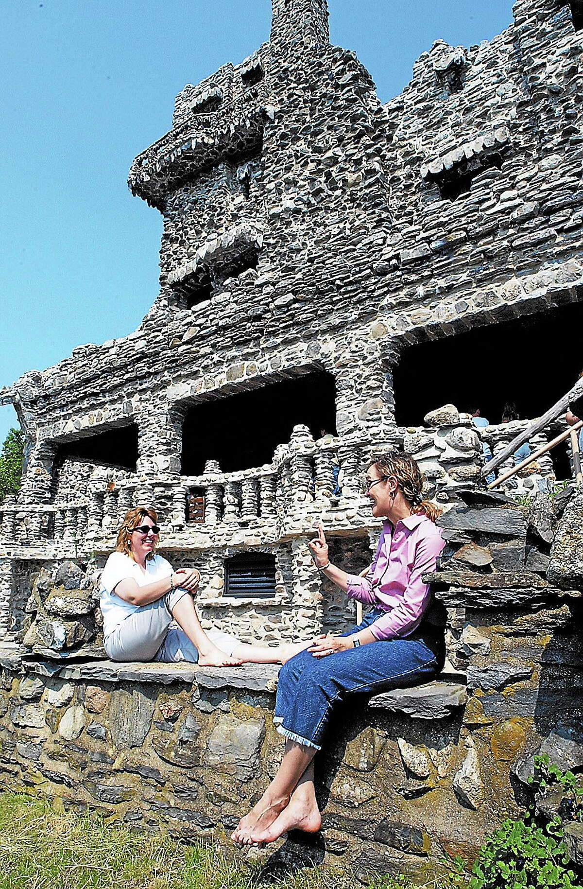Carol Woltersdorf of West Hartford and Allicia Flaherty of Glastonbury wait for their turn to view the inside of the Gillette Castle in East Haddam.
