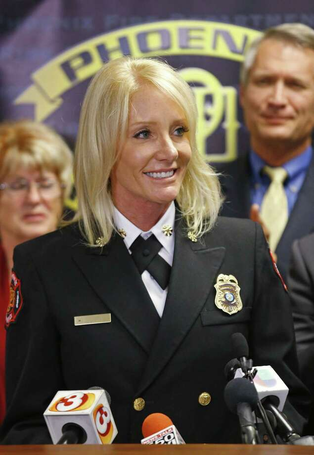 Kara Kalkbrenner is named Phoenix Fire Department's Chief Nov. 12, 2014, in Phoenix, Ariz. Kalkbrenner faced one of her first high-profile crises when a man was seen on fire on the street in Phoenix. Photo:  (AP Photo/The Arizona Republic, David Kadlubowski)  / The Arizona Republic
