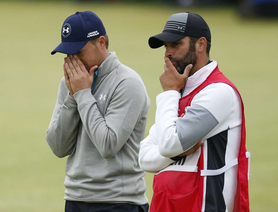 Jordan Spieth, left, and his caddie Michael Greller react after finishing the final round at the British Open on Monday. Photo: Jon Super — The Associated Press  / AP