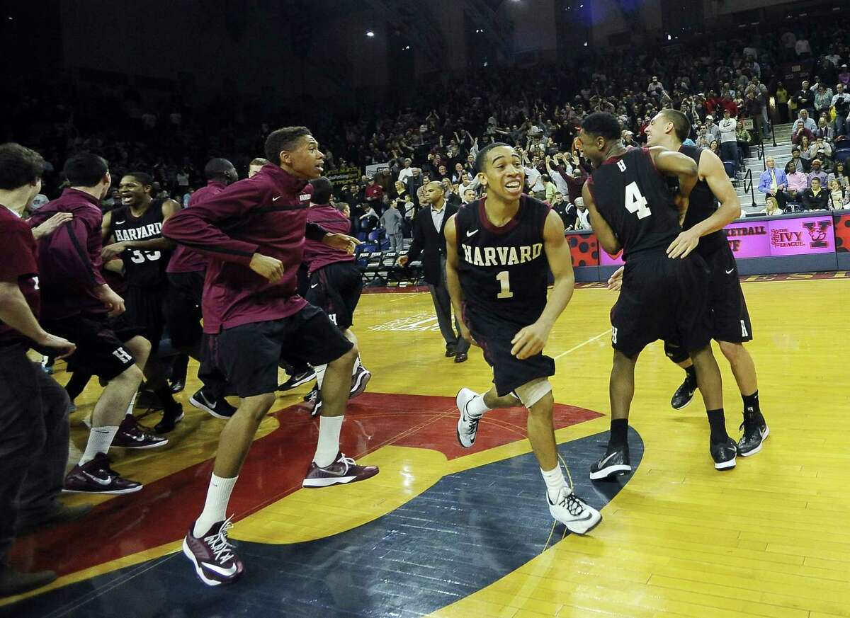 Harvard's Siyani Chambers (1) celebrates with his team after the Crimson beat Yale 53-51 in the Ivy League playoff on Saturday at The Palestra in Philadelphia.