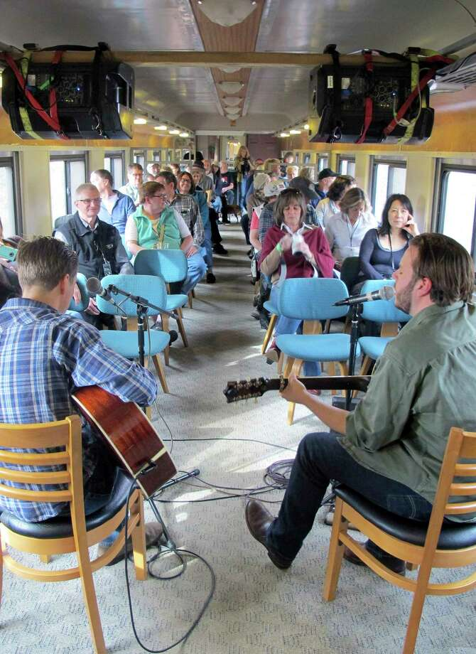 In this Saturday Nov. 7, 2015 photo, the Meadows Brothers, Dustin, left, and Ian, entertain passengers on the Roots on the Rails music train during its first East Coast Trip between Bellows Falls and Rutland, Vt. About 50 passengers spent the day listening to music while riding in vintage rail cars of the Green Mountain Express rolling through the countryside. Photo: AP Photo/Wilson Ring  / AP