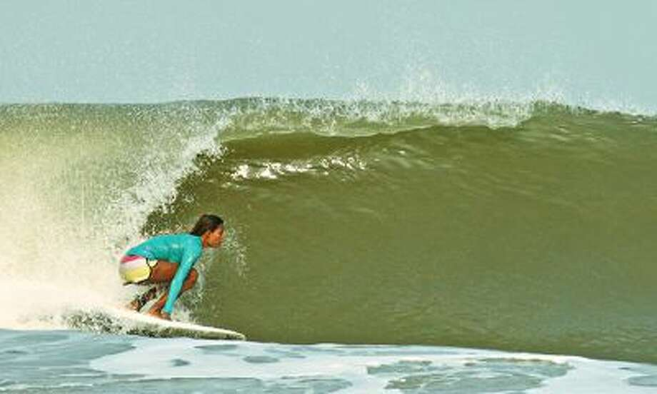 Ishita Malaviya, India's first female surfer, catches a wave. Photo: Photograph: Shaka Surf Club / Shaka Surf Club