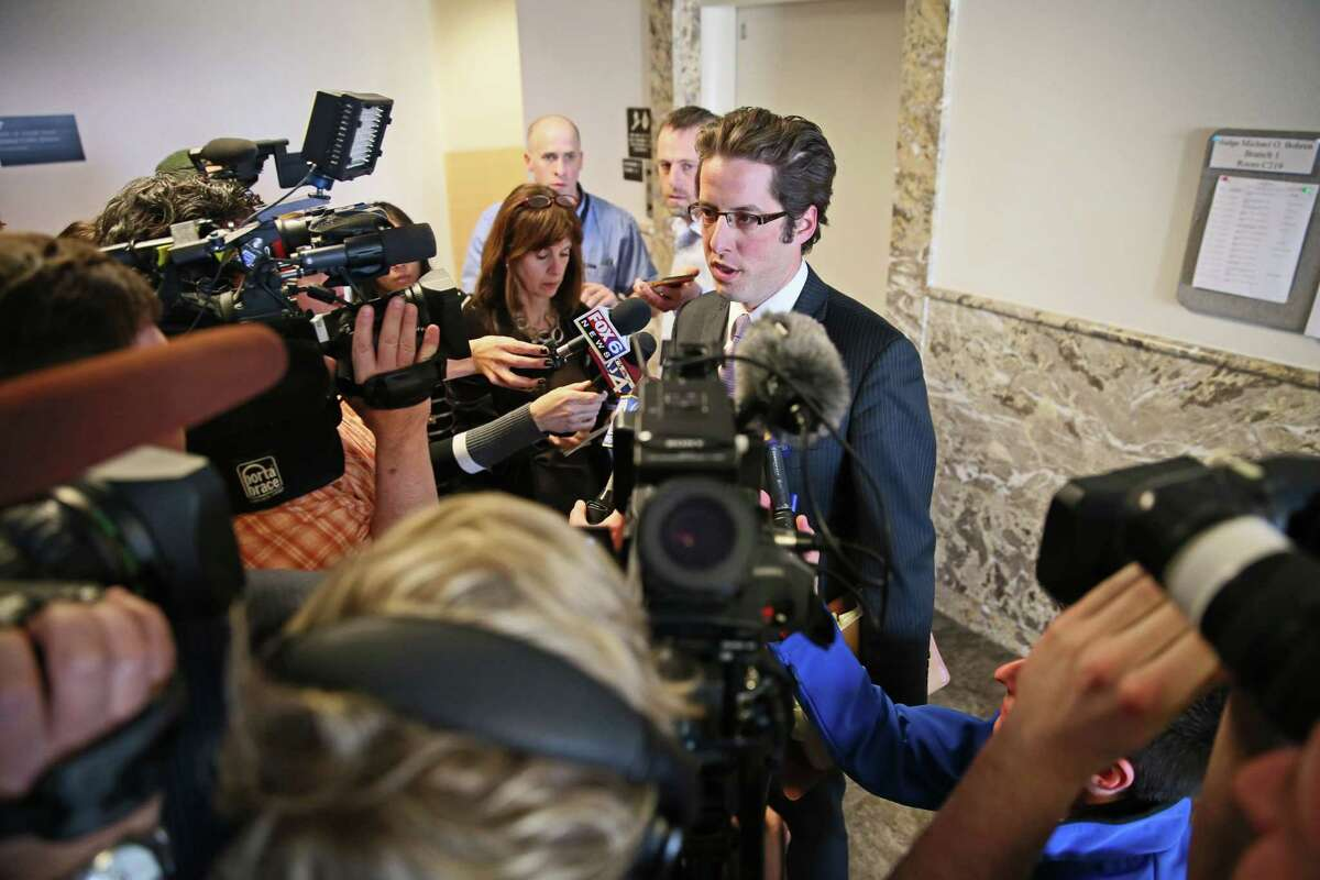 Defense attorney Anthony Cotton speaks to reporters in Milwaukee on Friday, March 13, 2015 after a judge decided to try the two 12-year-old suspects in the Slenderman stabbing case as adults. The two girls told detectives the attack was an attempt to please Slenderman, a fictional character they found on a horror website. If convicted, they could be sentenced to 65 years. (AP Photo/Milwaukee Journal-Sentinel, Michael Sears, Pool)