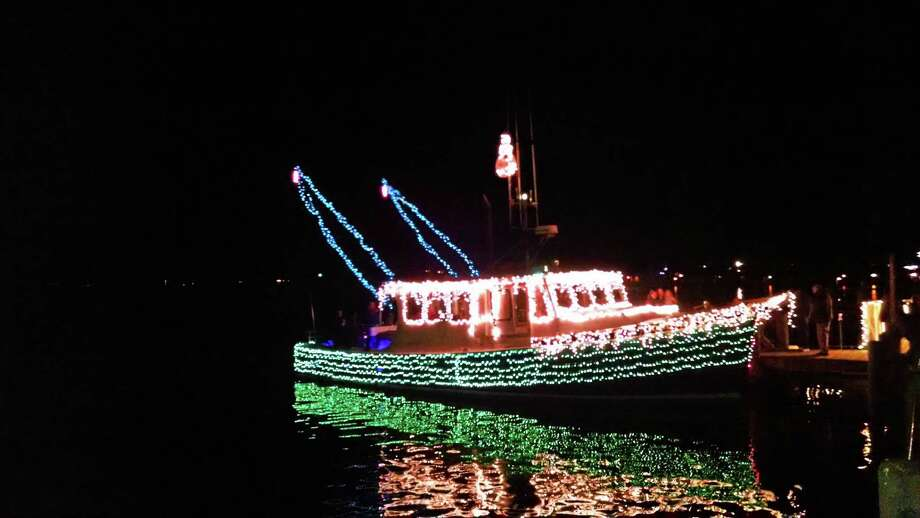 Contributed photoDecorated boats parade down the Connecticut River, part of the Trees in the Rigging celebration in Essex. Photo: Journal Register Co.