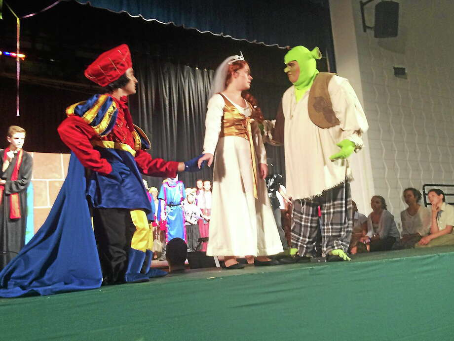 "The Young People's Center for Creative Arts summer show is ""Shrek: The Musical"" in East Hampton. Shown are Justin Keib (on the horse) from Wallingford as Lord Farquaad, Michael O'Sullivan as Shrek and Caitlin McQuade from Portland as Princess Fiona. The guards in the back from left are Tyler Litevitch, Riley Pawlewitz, Patrick Holden, Jack Caplan and Alec Gilarde (in the mask). Photo: Courtesy Rachel Mansfield"