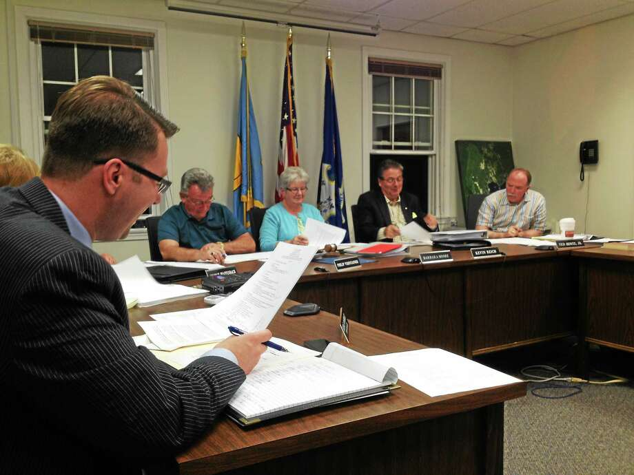 "The East Hampton Town Council, seen here in this file photo, is aiming for a public hearing in January for residents to voice their opinion on the <a href=""http://www.middletownpress.com/government-and-politics/20141112/east-hampton-forging-ahead-with-facilities-committee-despite-pushback"">Facilities Assessment Committee's</a> proposal for building a new police/fire complex and new town hall. Photo: Jeff Mill — The Middletown Press File Photo"