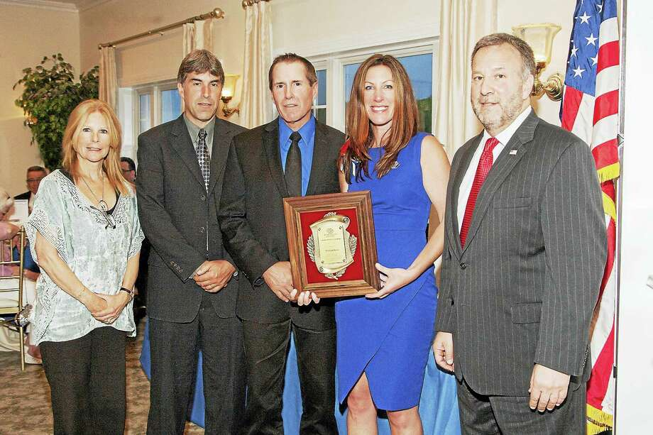 From left, Kim Ryan-Caro, sales manager; Rick Foehrenbach, president; Scott Foehrenbach, general sales manager; Shaye Roscoe, executive director, Boys & Girls Club of the Lower Naugatuck Valley; Ed DeMarseilles, COO. Photo: CONTRIBUTED PHOTO / Fred Ortoli Photography