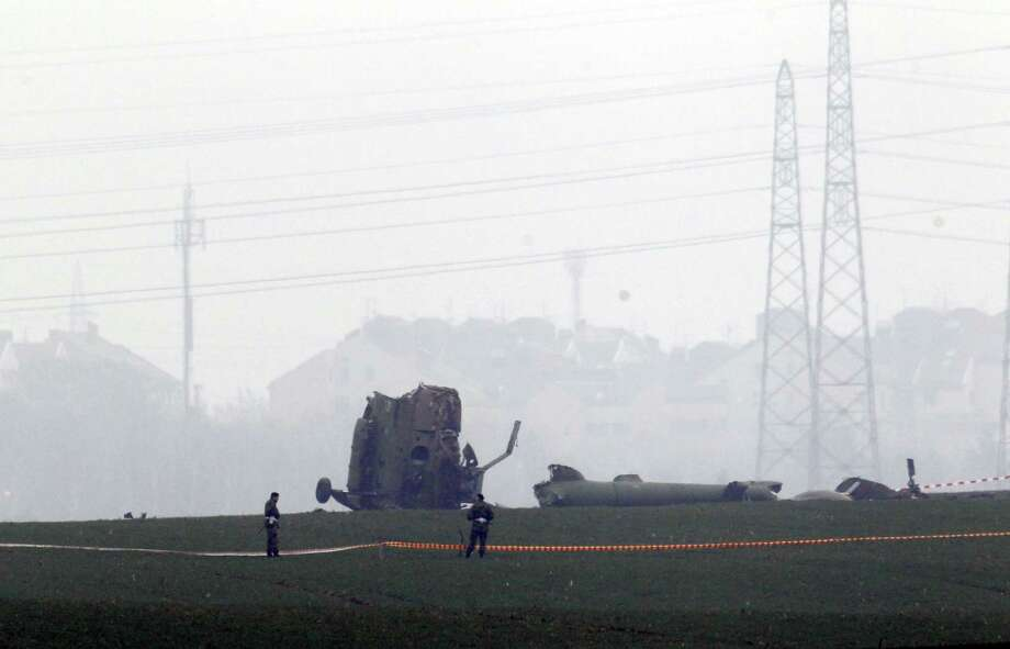 Serbian army soldiers guard the site of a helicopter crash on the outskirts of Belgrade, Serbia, Saturday, March 14, 2015. Officials say a Serbian military helicopter has crashed near Belgrade while evacuating a sick baby from south of the country, killing all seven people on board. (AP Photo) Photo: AP / AP