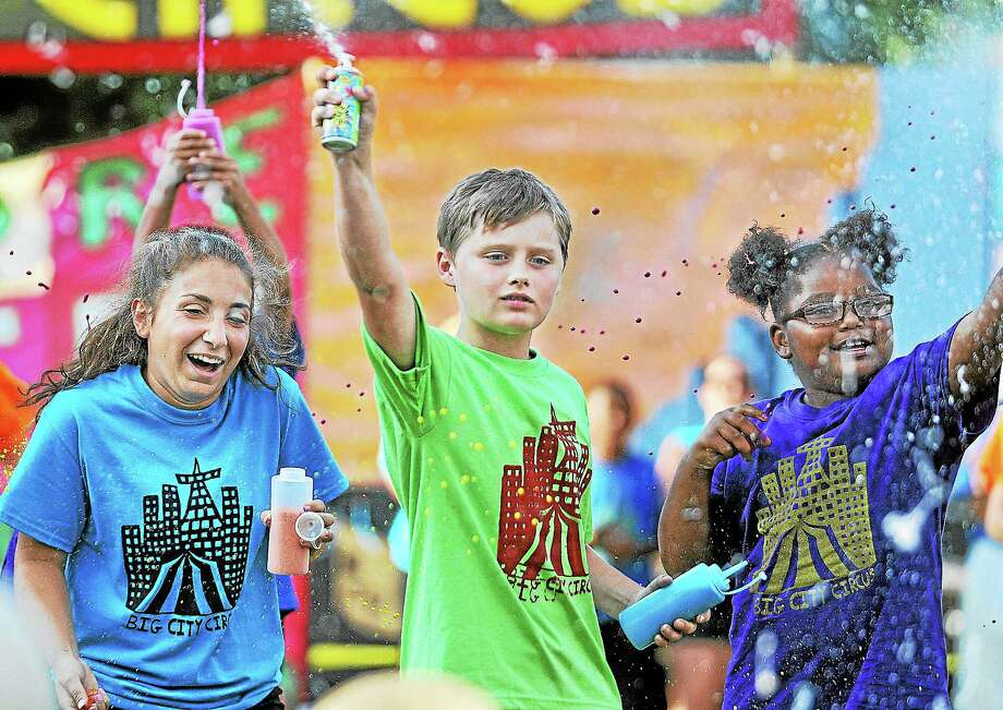 Performers in the Oddfellows Playhouse Youth Theater's 25th Children's Circus of Middletown: The Big City Circus shoot silly string towards the crowd Friday evening at  Macdonough School in Middletown. The program is sponsored by the Middletown Commission on the Arts and Middlesex United Way. Catherine Avalone - The Middletown Press ¬  ¬ Photo: Journal Register Co. / TheMiddletownPress