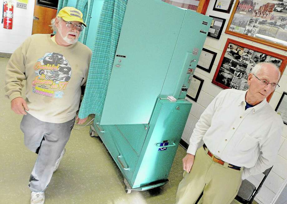 Middletown resident Joel Pear exits the voting machine at South Fire District in this file photo. Photo: File Photo  / TheMiddletownPress