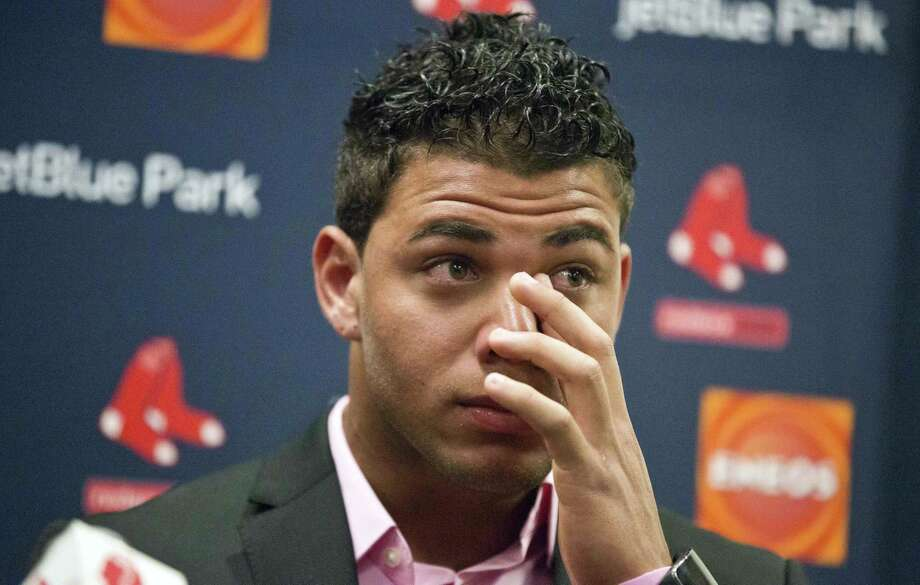 Boston Red Sox infielder Yoan Moncada wipes away tears as he speaks about his agent, David Hastings, during a press conference Friday in Fort Myers Fla. Photo: Brynn Anderson — The Associated Press  / AP