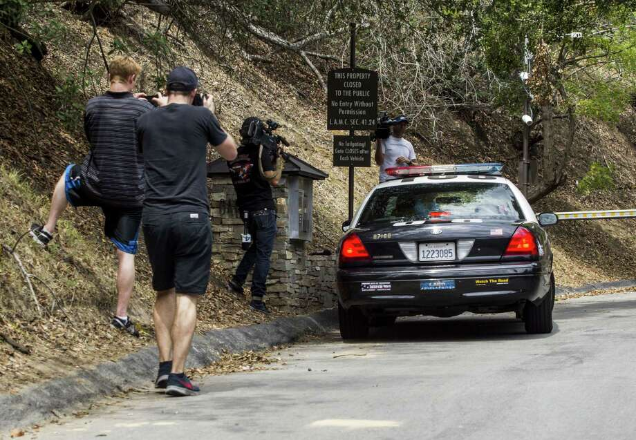 A police car arrives an entrance to the home of actress Demi Moore in Beverly Hills on July 19, 2015. Coroner's officials say a 21-year-old man accidentally drowned in the backyard pool of a Los Angeles home owned by actress Demi Moore. Photo: AP Photo/Ringo H.W. Chiu  / FR170512 AP