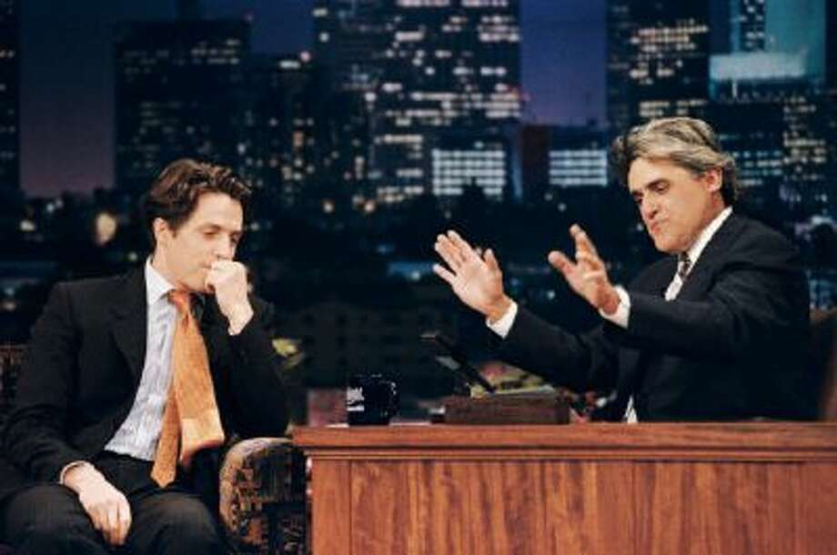 "This July 10, 1995 photo released by NBC shows actor Hugh Grant, left, during an interview with host Jay Leno on ""The Tonight Show with Jay Leno,"" in Burbank, Calif."