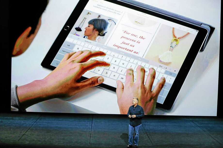 Phil Schiller, Apple's senior vice president of worldwide marketing, introduces the new iPad Pro at the Apple event in the Bill Graham Civic Auditorium in San Francisco on Sept. 9, 2015. Photo: AP Photo/Eric Risberg  / AP