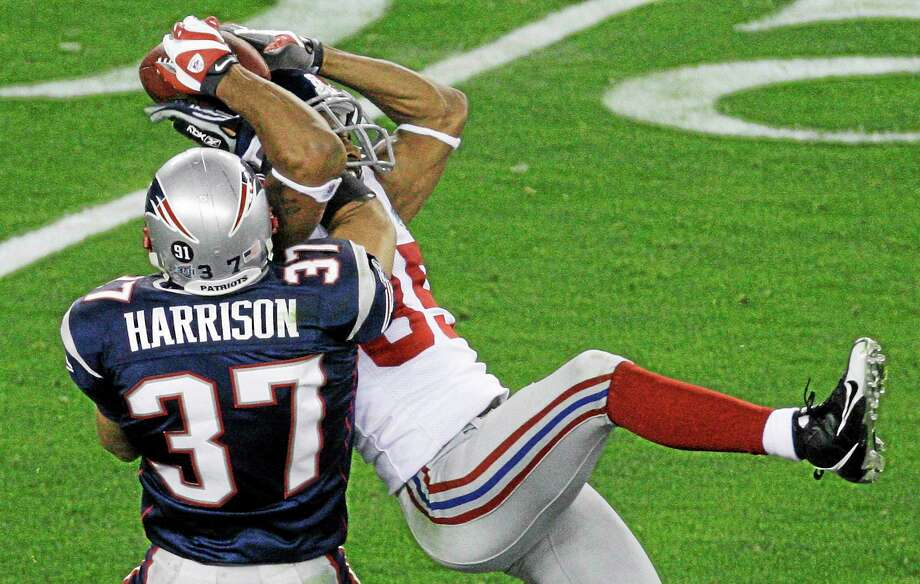 In this Feb. 3, 2008 file photo, New York Giants receiver David Tyree, right, makes a catch against New England Patriots safety Rodney Harrison during the fourth quarter of Super Bowl XLII at University of Phoenix Stadium in Glendale, Ariz. Photo: Charlie Riedel — The Associated Press File Photo  / AP2008