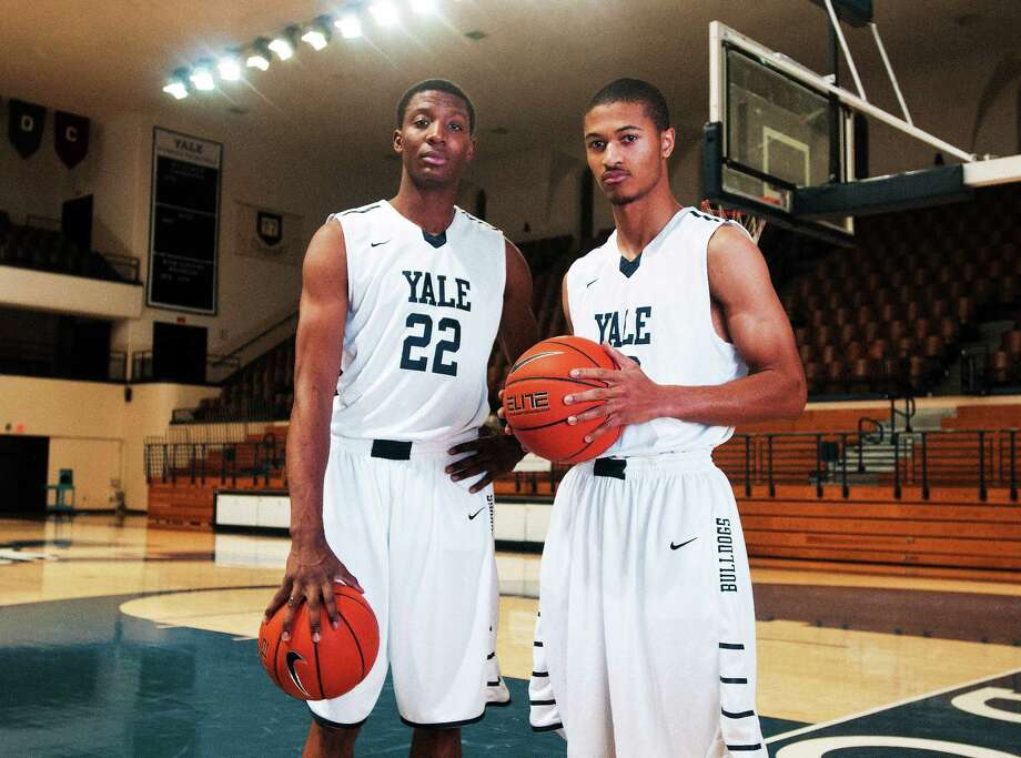 Justin Sears, left, Javier Duren and the Yale basketball team tip off the season on Friday against Quinnipiac. Photo: Peter Casolino — Register File Photo
