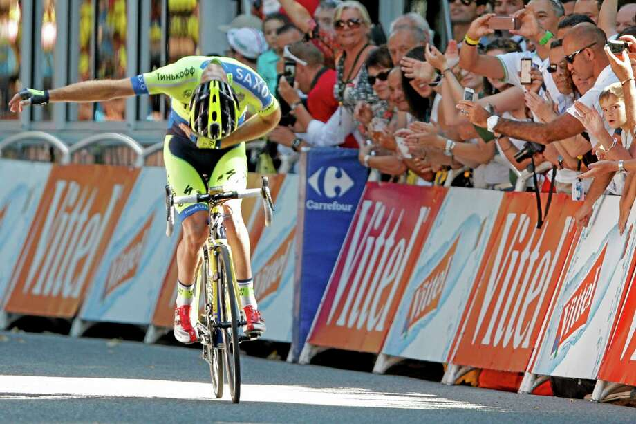 Michael Rogers bows for cheering spectators as he crosses the finish line to win the sixteenth stage of the Tour de France on Tuesday. Photo: Peter Dejong — The Associated Press  / AP