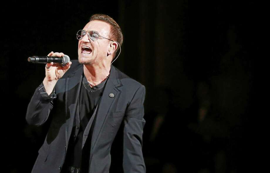 Bono of U2 performs on stage during the Oscars at the Dolby Theatre on March 2, 2014, in Los Angeles. Photo: Photo By Matt Sayles/Invision/AP  / AP2014