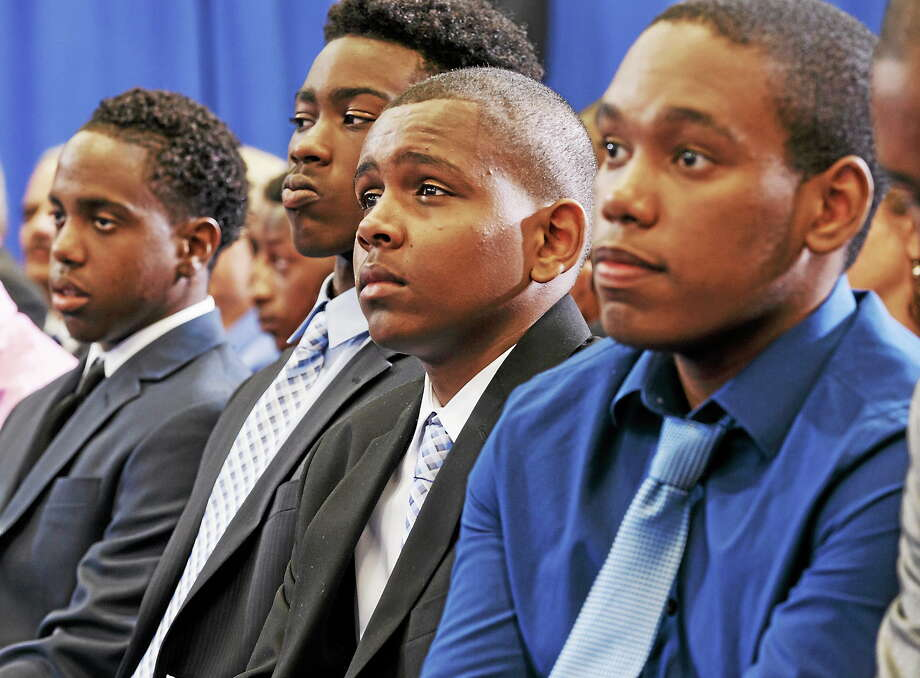 "Young African-American men listen intently as President Barack Obama speaks at a ""town hall meeting"" about the My Brother's Keeper Initiative, at the Walker Jones Education Campus in Washington on July 21, 2014. Photo: AP Photo/J. Scott Applewhite  / AP"