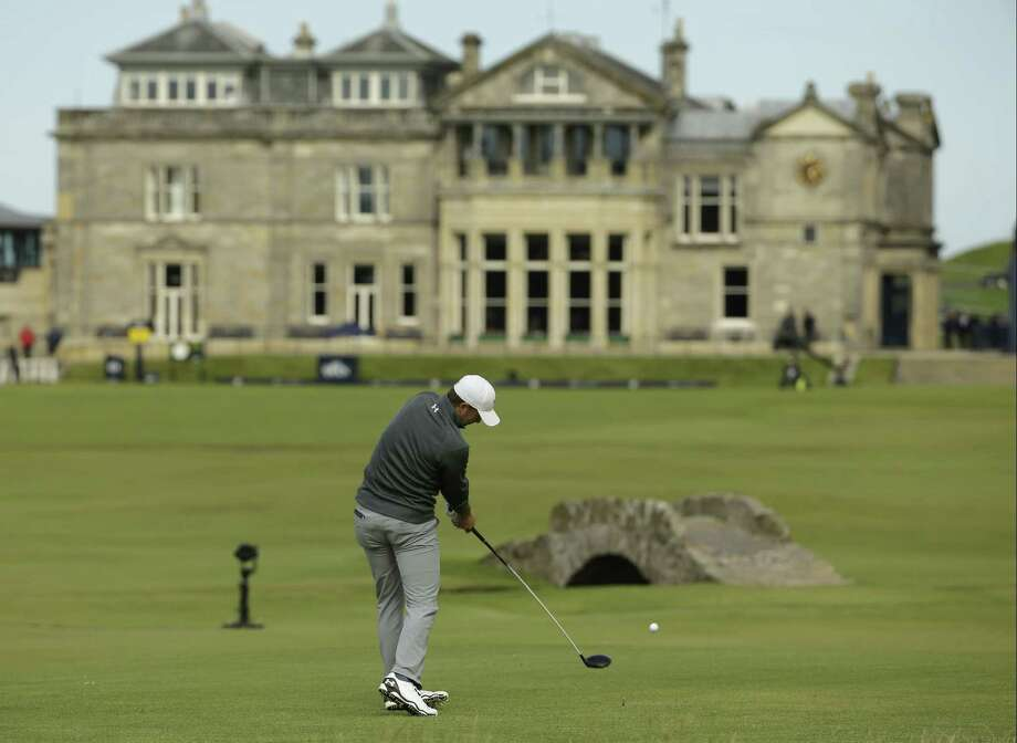 Jordan Spieth drives the ball from the 18th tee during the third round of the British Open on Sunday. Photo: David J. Phillip — The Associated Press  / AP