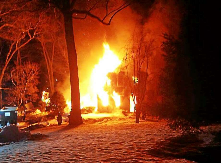 Fire crews from around the region converged on Otter Cove late Thursday night to battle a two-alarm house fire. No one was injured, and the cause of the fire remains under investigation. Photo: Photo From The Old Saybrook Fire Department