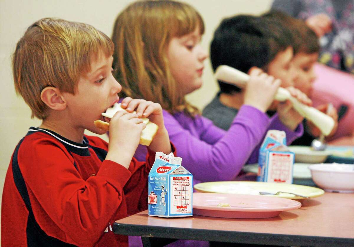 FILE- In this Feb. 3, 2010 file photo, students eat lunch at Sharon Elementary School in Sharon, Vt. Vermont ranks second in the country in an annual report of kids' well-being. The Annie E. Casey Foundation's Kids Count report released Monday shows improvements in eight areas like in the percentage of children with health insurance and fewer teen births but poverty continues to be a problem. Vermont fell slightly in the percentage of children with parents who lack secure employment to 29 percent. New Hampshire was the top-ranked state, followed by Vermont and Massachusetts. Nevada, Mississippi and New Mexico took the bottom three spots. Overall, Vermont ranked third in the country in education and family and community and fourth in health.