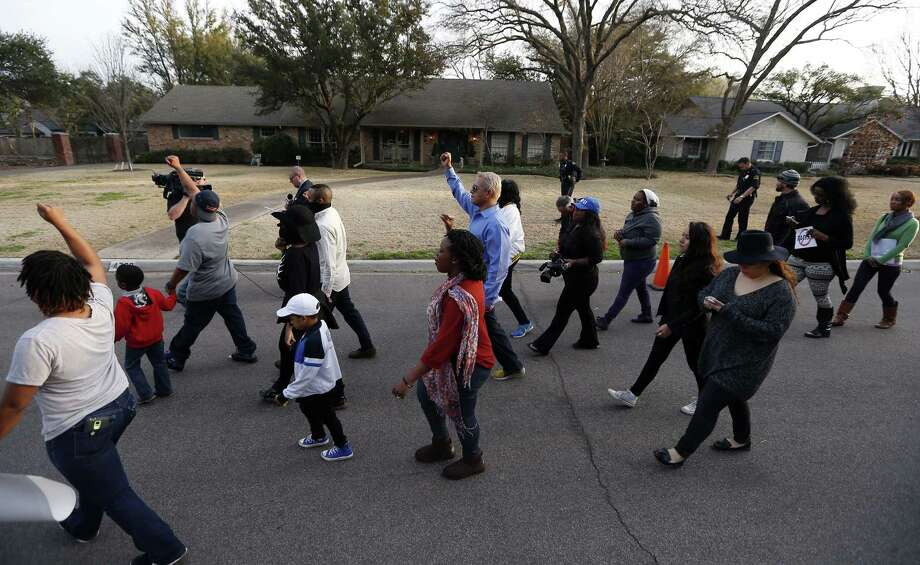 About two-dozen protesters march outside the family home, background, of a former University of Oklahoma Sigma Alpha Epsilon fraternity member Parker Rice, Wednesday, March 11, 2015, in Dallas. Rice and several other fraternity members were seen on video chanting a racist song. (AP Photo/Brandon Wade) Photo: AP / FR168019 AP