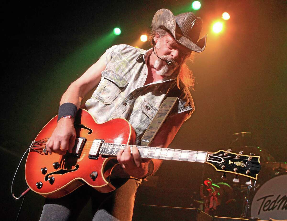 FILE - This Aug. 16, 2013 file photo shows Ted Nugent performing at Rams Head Live in Baltimore. A Native American tribe has canceled an Aug. 4, 2014, concert by Nugent at its casino. The Coeur d'Alene Tribe on Monday, July 21, 2014, said that the cancellation of the concert at the casino in Worley was because of what it called the rocker's