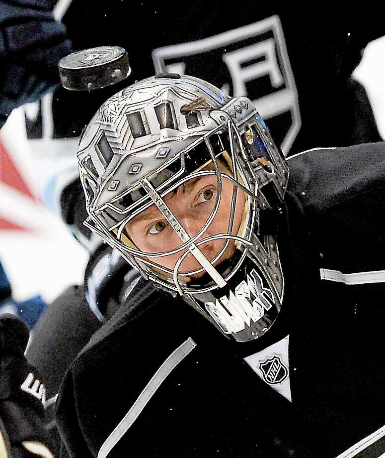 A puck flies in front of Los Angeles Kings goalie Jonathan Quick during the first period of an NHL hockey game against the Vancouver Canucks, Saturday, Nov. 9, 2013, in Los Angeles.  (AP Photo/Mark J. Terrill) Photo: AP / AP2013