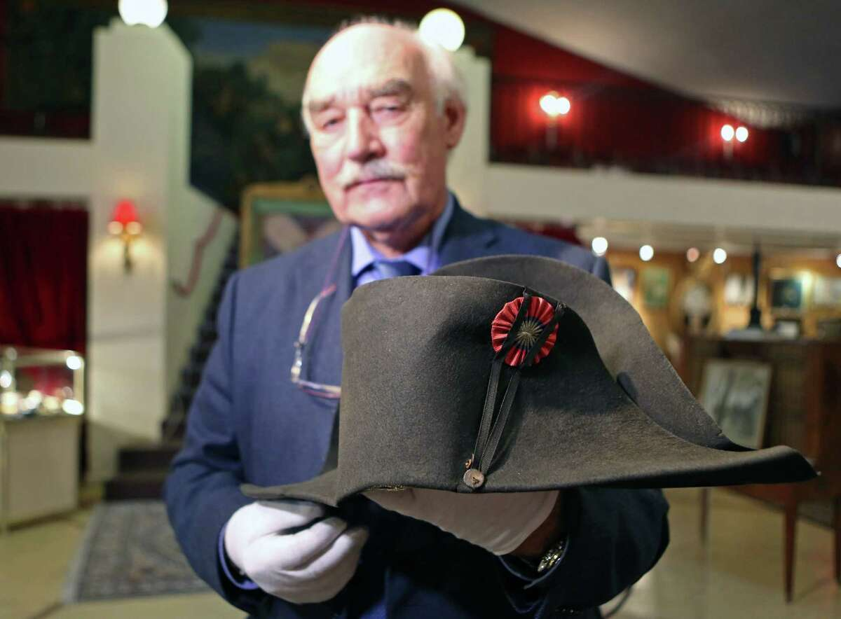 Napoleon expert Jean Claude Dey presents Napoleon's hat, from the Napoleonic collection of the Palais de Monaco, in Fontainebleau, south of Paris, France, Wednesday Nov. 12, 2014. The hat is part of the Napoleonic collection gathered by Prince Louis II, that will be put on sale Nov. 15 and Nov. 16 in Fontainbleau. More than 1,000 objects among which is Napoleon's hat, will be put on sale at this auction. Napoleon bicorn hat is on display next to the chateau where the general lived when he wasnít leading troops into battle across Europe. The felt is a little weathered by age and use, though no oneís worn it since Napoleonís veterinarian, who received from the French leader as a gift, but auctioneers are hoping to fetch 500,000 euros ($623,000) for it at the weekend auction. (AP Photo/Remy de la Mauviniere)