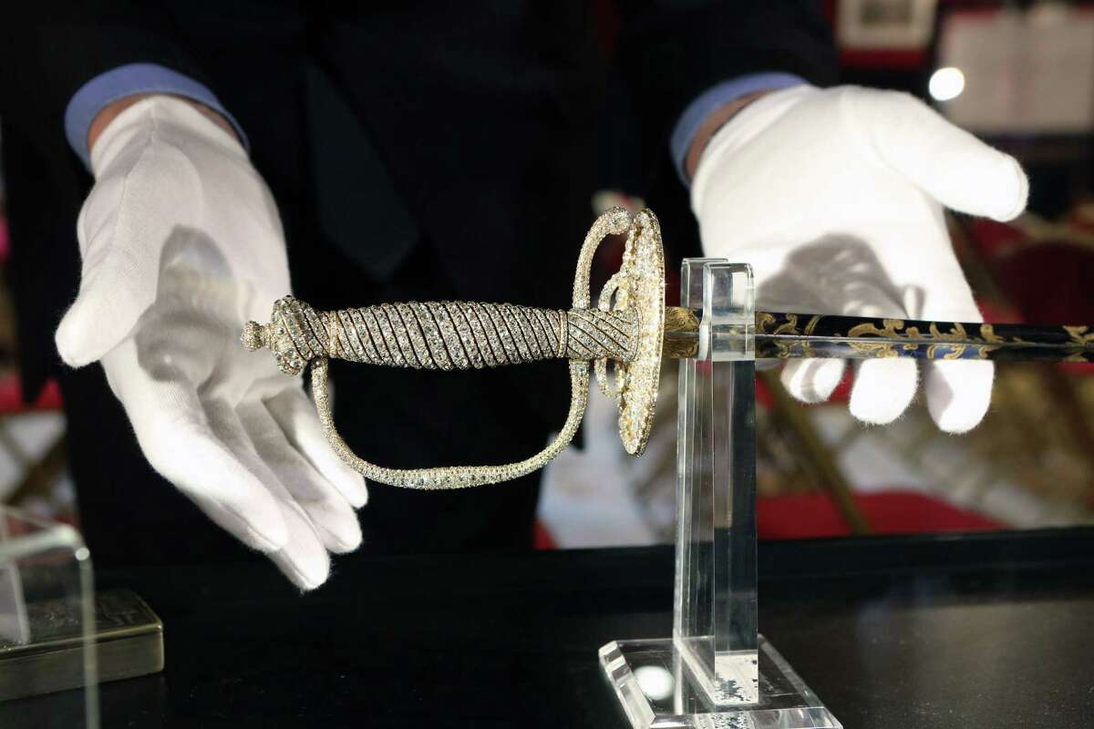 A jeweled dress sword from the Napoleonic collection of the Palais de Monaco, is presented in Fontainebleau, south of Paris, France, Wednesday Nov. 12, 2014. This sword is part of the Napoleonic collection of the Palais de Monaco, gathered by Prince Louis II, that will be put on sale Nov. 15 and Nov. 16 in Fontainbleau. More than 1,000 objects will be put on sale at this auction. (AP Photo/Remy de la Mauviniere)