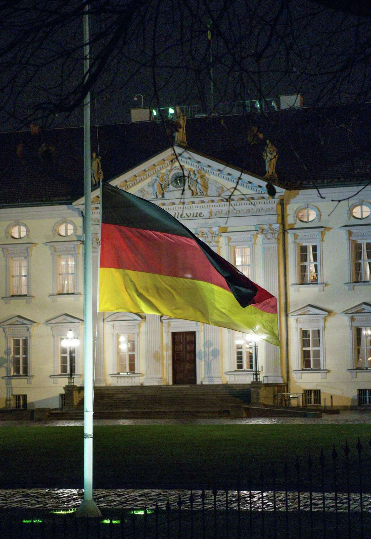 The German flag flies at half-mast in respect for former German chancellor Helmut Schmidt, outside Bellevue palace, the official residence of the German president, in Berlin, Germany, Tuesday, Nov. 10, 2015. Schmidt died Tuesday at the age of 96.