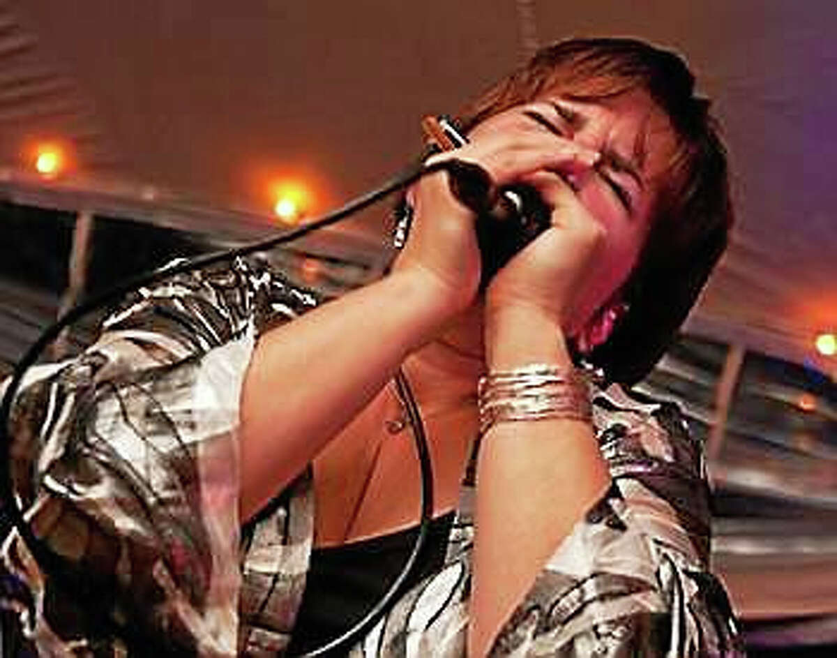 Photo by Jenn DeanDiane Blue from Boston performs in the Harmonica Showcase at Black-Eyed Sally's on Saturday.