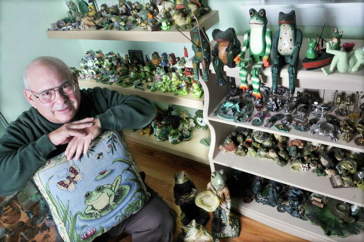 """Middletown resident Howard Rulnick in his """"Frog Room,"""" where he displays hundreds of frogs from a collection he started 35 years ago."""