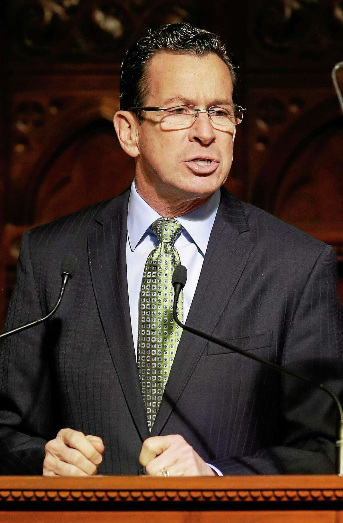 File - Connecticut Gov. Dannel P. Malloy gestures with his fists as he emphasizes a point during his 2014 State of the State address.