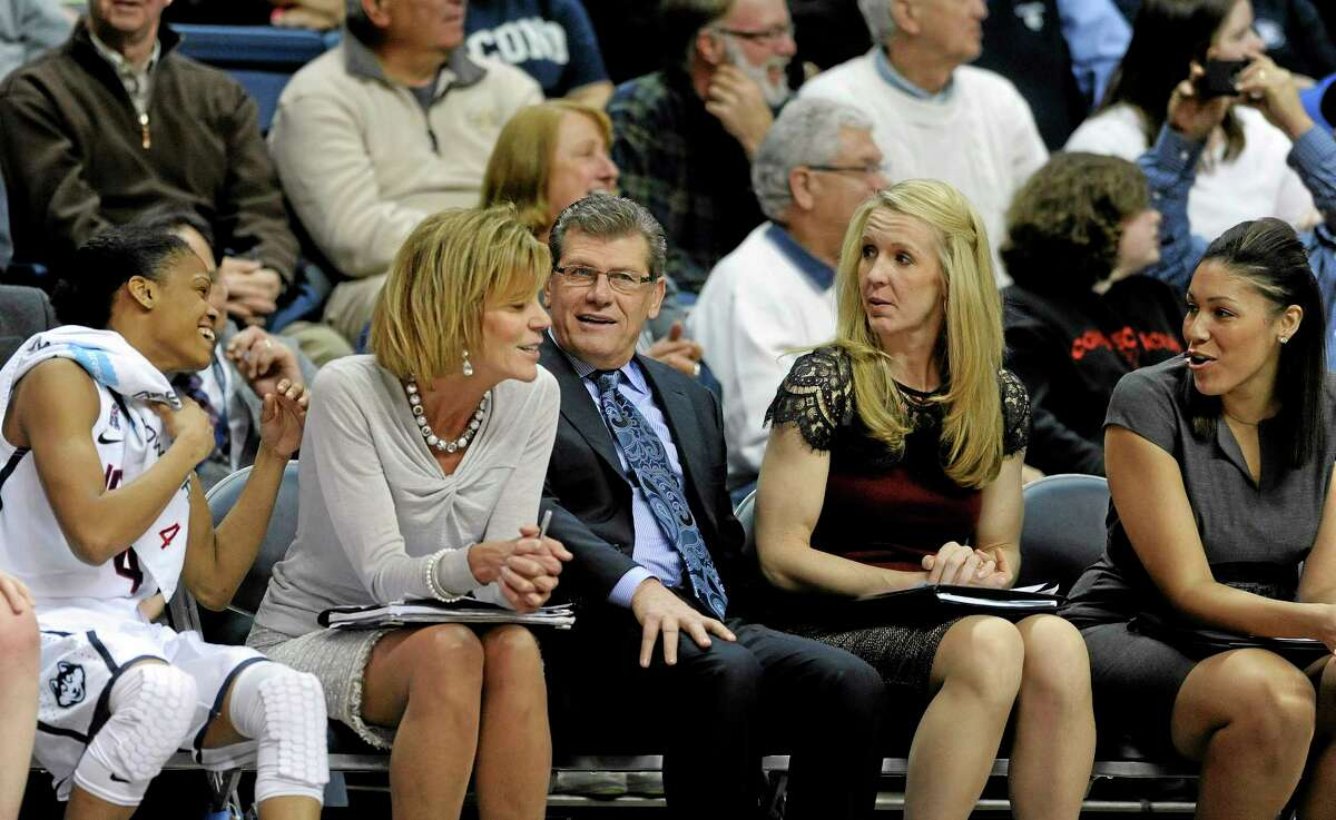 UConn head coach Geno Auriemma shares a light moment with his bench during the second half of the Huskies' 102-41 victory over SMU on Tuesday in Storrs.
