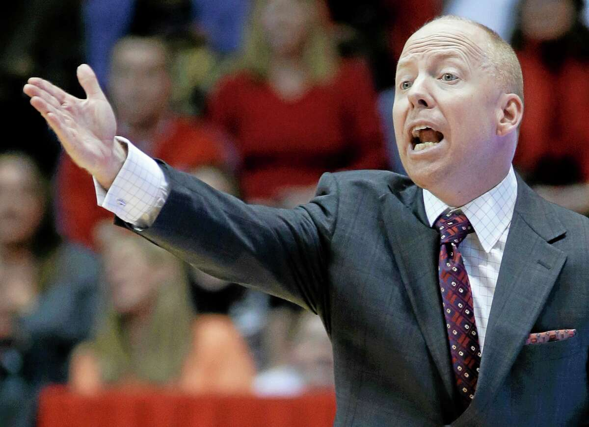 Coach Mick Cronin and the seventh-ranked Cincinnati Bearcats will host No. 22 UConn Thursday night in a key AAC matchup.