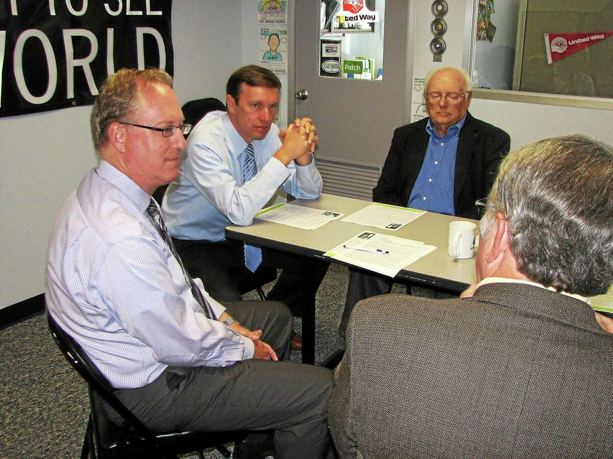 U.S. Sen. Chris Murphy, second from left, visits with the Middlesex County Coalition on Housing & Homelessness in late 2014 to talk about issues facing families in Middlesex County. Among those in attendance were Kevin Wilhelm, far left, of the local chapter in Middletown.