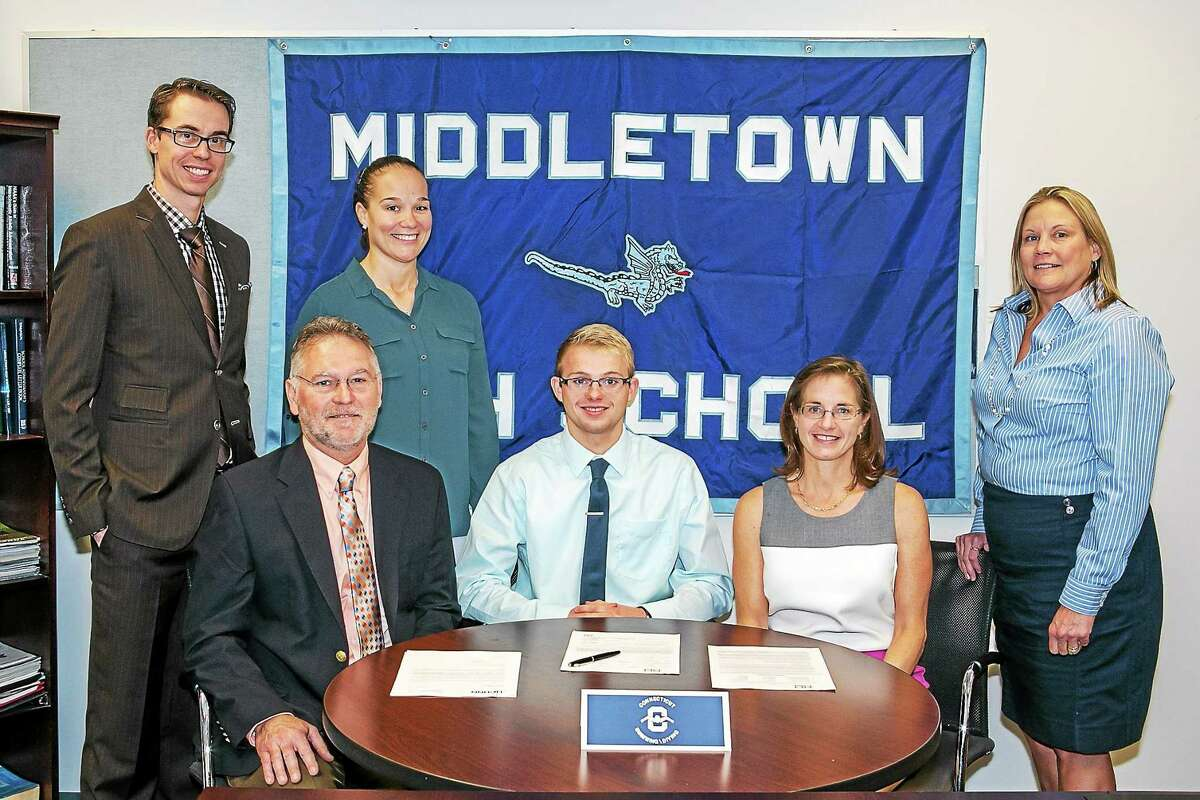 Middletown Swimmer Matthew Dagenais, signed his Letter of Intent to UConn on Wednesday. Back row from left: Swim coach Trevor Charles, Athletic Director Elisha DeJesus, Principal Colleen Weiner. Front row from left: Dagenais's father Russell, Matthew, and mother Tess.