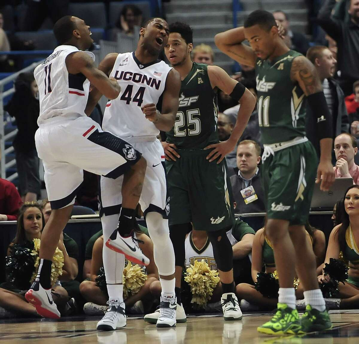 UConn's Ryan Boatright, left, and Rodney Purvis react as South Florida's Troy Holston Jr., center right, and Anthony Collins look on during the first half Thursday.
