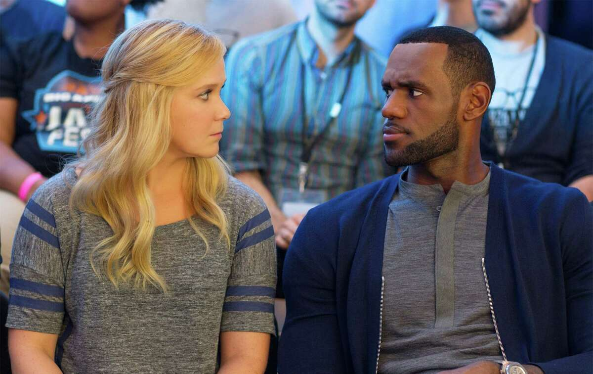 """This image released by Universal Pictures shows Amy Schumer, left, and LeBron James, in a scene from the comedy, """"Trainwreck."""""""